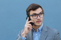 Impatient businessman calling by phone.  stock photography