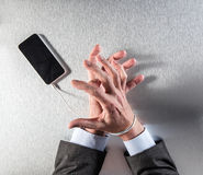 Impatient businessman hands obsessed with mobile slavery and technology dependence Stock Photography