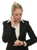 Impatient businesswoman checking her watch Royalty Free Stock Image