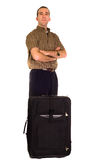 Impatient Man. An impatient man waiting for something with his luggage, isolated against a white background stock image