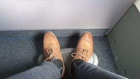 Impatient shoes in a flight tapping waiting for long hours.  stock footage
