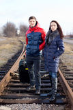 Impatient young couple waiting on the train tracks Royalty Free Stock Photography