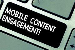 Impegno contento mobile del testo della scrittura Significato di concetto che spinge le esperienze coercitive nell'intenzione mob fotografia stock libera da diritti