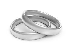 Impegno due o fedi nuziali d'argento per le nozze delle coppie Fotografia Stock Libera da Diritti