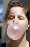 Impending Boom. Lady Closes Her Eyes In Preparation Of A Imminent Pop While Blowing A Huge Gum Bubble Royalty Free Stock Image