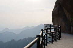 The impending plank footpath on Sanqing mountain. The impending plank footpath with handrails on Sanqing mountain stock photography