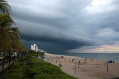 Impending Rain Storm at Deerfield Beach, Florida. A giant sheet of rain is imminent as it approaches the volleyball courts on Deerfield Beach, Florida in a dark Stock Photo