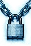 Impenetrable security conceptually represented with lock and chain. Impenetrable security concept. Closeup image of chain and locked padlock  on blue steel white royalty free stock photography
