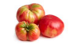 Imperfect heirloom organic tomato. Es isolated on white background stock photography
