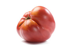 Imperfect organic big fresh red tomato isolated. Closeup stock image