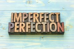 Imperfect perfection word abstract. In vintage letterpress wood type prinitng blocks royalty free stock photo