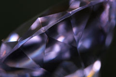 Imperfect purple diamond. A clear purple diamond on black, cropped macro shot Royalty Free Stock Photos
