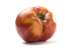 Imperfect red ripe organic tomato isolated. Closeup stock photo