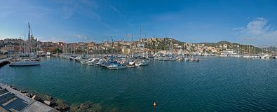 Liguria, Italy: The port of Imperia. Yachts and sailboats anchored in the port of Imperia, the city in the background stock images