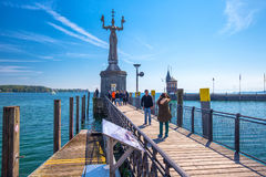 Imperia statue in harbor of Konstanz city with a view to lake Constance. Stock Photos