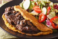 Imperial beef steak with mushrooms, scrambled eggs and vegetable Stock Images