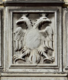 Imperial double-headed eagle. Double-headed eagle, symbol of the holy roman empire, on a Venice wall royalty free stock photos