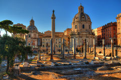 Imperial Forum  and Trajan columns in Rome. Imperial forum and trajan columns in the center of Rome, Italy.with the church of Loreto and modern buildings in Royalty Free Stock Photos