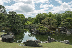 An imperial garden and pond in Nijo Castle of Kyoto. Nijo Castle also known as Second Palace, Ninomaru Palace, a flatland castle founded 1679, Kyoto. Japan Royalty Free Stock Photography