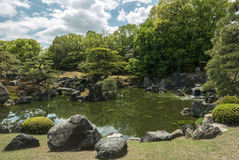 An imperial garden and pond in Nijo Castle of Kyoto. Nijo Castle also known as Second Palace, Ninomaru Palace, a flatland castle founded 1679, Kyoto. Japan royalty free stock image