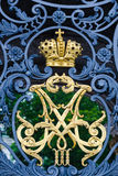 Imperial monogram on Hermitage front gate. ST PETERSBURG - JUNE 30, 2011: A gilt Russian imperial monogram of Alexander III and Maria Feodorovna on the Hermitage stock photography