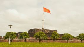 Imperial Royal Palace of Nguyen dynasty in Hue and fkag. Vietnam. stock image