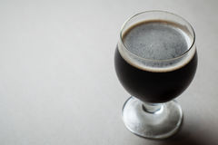 Imperial stout on gray Royalty Free Stock Images