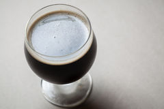 Imperial stout on gray Royalty Free Stock Photos