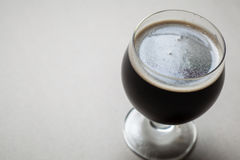 Imperial stout on gray Royalty Free Stock Image