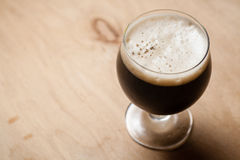 Imperial stout on wood Royalty Free Stock Photos