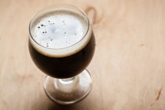 Imperial stout on wood Royalty Free Stock Images