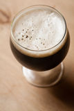 Imperial stout on wood Stock Image
