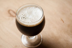Imperial stout on wood Royalty Free Stock Photo