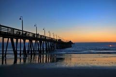 Imperialistisk strand Pier Sunset Royaltyfria Foton