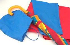 Impermeabile ed ombrello del bambino Fotografia Stock
