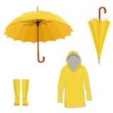 Impermeable, botas, paraguas Fotografía de archivo libre de regalías