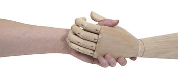 Impersonal Agreements. Shown by an agreement handshake with a wooden figure that is not human - path included Stock Photo
