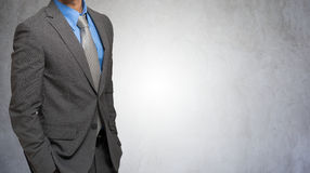 Impersonal portrait of a businessman against a grey background Royalty Free Stock Photo