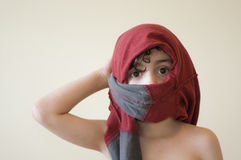 Impersonating an Arab. Young Hispanic boy impersonates an Arab after a class about this culture Royalty Free Stock Photo