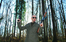Impersonating revolutionary. Young man impersonating revolutionary in the forest with guns Stock Photography