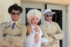 Impersonator Marylin Monroe and boys Royalty Free Stock Images