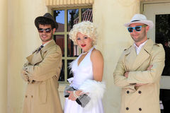 Impersonator Marylin Monroe and boys Stock Image