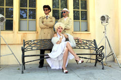 Impersonator Marylin Monroe and boys Stock Photography