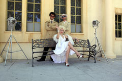 Impersonator Marylin Monroe and boys in Barselona. Marylin was a Stock Photo