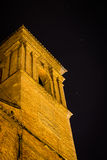 Imperterritus. Tower of an ancient church against the nightly sky Stock Photo
