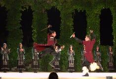 Impetuous sword duel. Georgian dancers in spirited sword duel dance at Summer Theater Varna city,Bulgaria Stock Photography