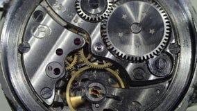 Impianti del meccanismo dell'orologio video d archivio
