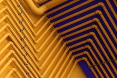 Impianto idraulico nell'azzurro e nel colore giallo Fotografia Stock