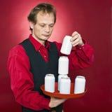 Impilamento delle latte Immagine Stock