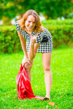 Impish girl posing on the grass in park Stock Images